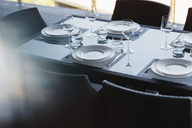 Set table in modern dining room - CAIF19825