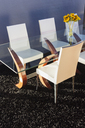 Chairs at modern dining table - CAIF19858