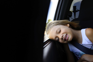 Girl napping while sitting in car - CAVF10426