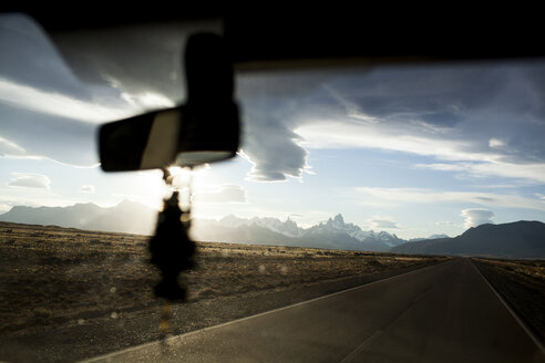 Scenic view clouds over mountains seen through car windshield - CAVF10561