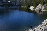 High angle view of hiker standing by Snow Lake - CAVF10591