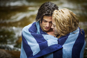 Affectionate couple wrapped in towel - CAVF10763