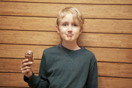 Portrait of cute boy holding ice cream - CAVF10934
