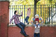 Family enjoying by fence at retaining wall - CAVF10976