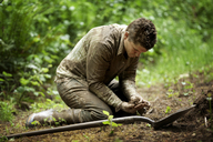 Farmer searching in mud at forest - CAVF11351