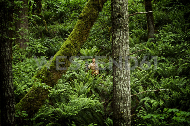 Farmer standing in forest - CAVF11357