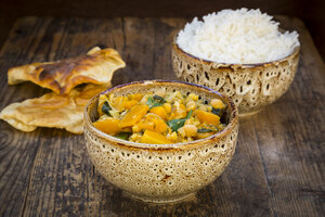 Curry dish with cauliflower, butternut pumpkin, spinach and coriander, papadam and rice - LVF06795