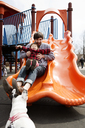 Father and daughter enjoying sliding at playground - CAVF12055