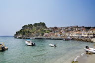 Boats on sea by houses against clear sky during sunny day - CAVF12433