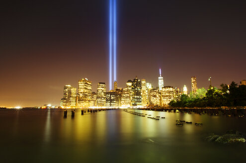 Idyllic view of river and illuminated city with Tribute in Light at night - CAVF12448