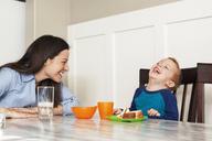 Mother looking at son having breakfast - CAVF12481
