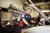 Mechanic repairing car at garage - CAVF13156