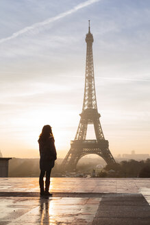 Silhouette woman looking at Eiffel Tower against sky - CAVF13417