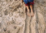 Cropped image of boy crawling in sand - CAVF14491