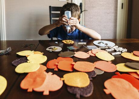 Boy making art at home - CAVF14545