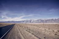Scenic view of Death Valley National Park against blue sky - CAVF14917