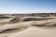 Scenic view of sand dunes against sky - CAVF15136