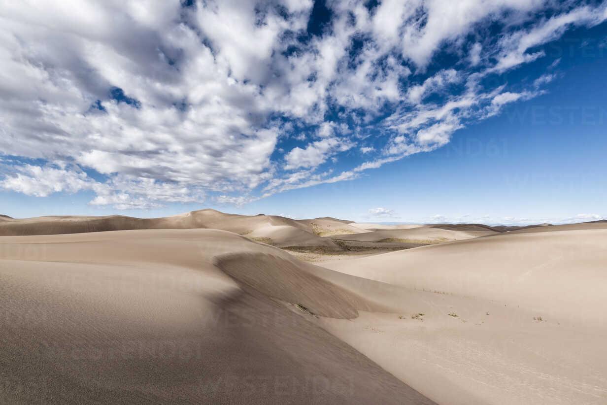 Desert landscape against cloudy sky - CAVF15151 - Cavan Images/Westend61