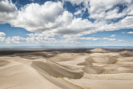 View of sand dunes against cloudy sky - CAVF15154