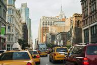 Cars on city street amidst buildings - CAVF15462