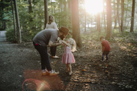 Family enjoying vacation in forest - CAVF15588