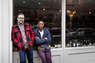 Portrait of confident Small Business owners standing outside wine shop - CAVF15891