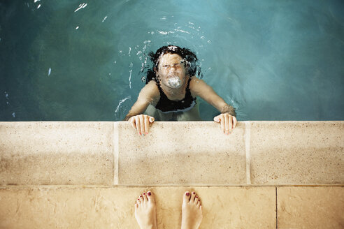 High angle view of girl swimming in pool - CAVF15993