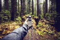 Cropped image of hiker holding navigation equipment at Humboldt Redwoods State Park - CAVF16227