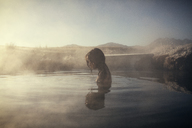 Side view of woman swimming at Mammoth Lake Hot Springs - CAVF16705