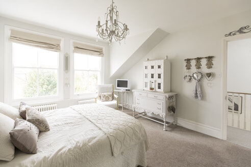 White, luxury home showcase interior bedroom with chandelier - CAIF20136