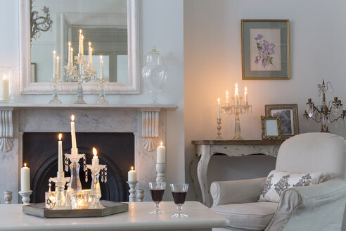 Candlelit luxury home showcase interior living room with fireplace - CAIF20151