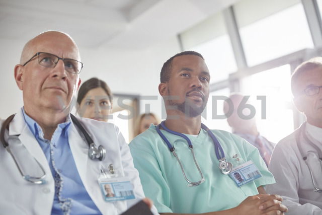 Attentive surgeons, doctors and nurses listening in meeting - CAIF20154