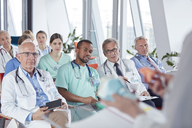Surgeons, doctors and nurses listening in conference audience - CAIF20160