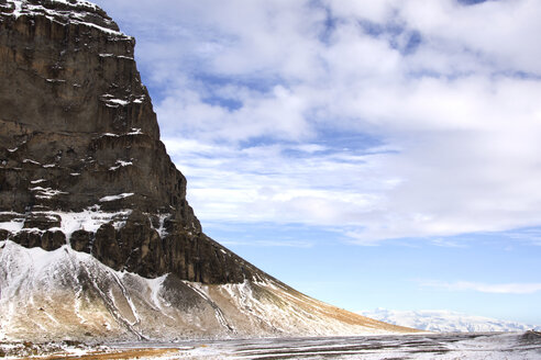Majestic view of cliff during winter against cloudy sky - CAVF18003