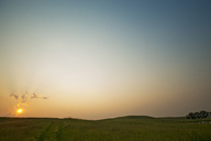 Scenic view of landscape against clear sky during sunset - CAVF18675
