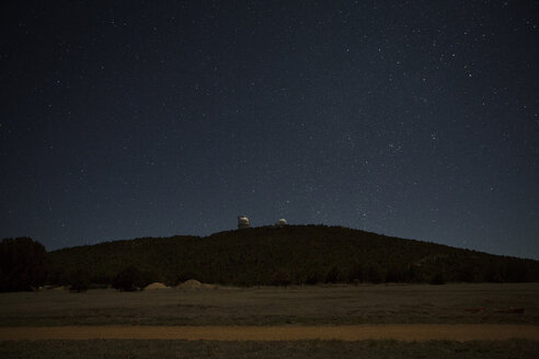 Scenic view of landscape against starry sky at night - CAVF19749