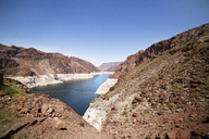 Lake Mead amidst rock formations against clear blue sky - CAVF19884