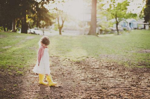 Girl walking on field - CAVF20430