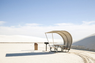 Hooded beach chair at White Sands National Monument against sky - CAVF20751