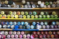 Close-up of spray paints arranged on shelves - CAVF20985
