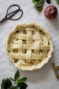Overhead view of raw apple pie on table - CAVF21030