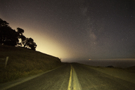 Mountain road against sky at night - CAVF21219