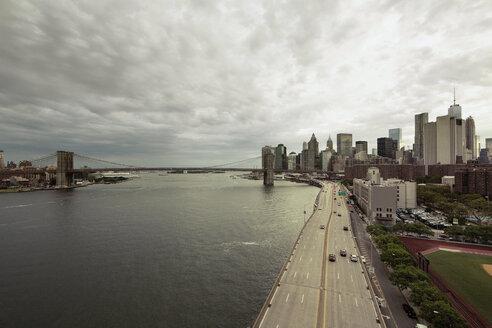 Cityscape by Brooklyn Bridge against cloudy sky - CAVF21240