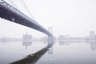 Williamsburg Bridge over river in foggy weather - CAVF21294