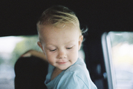 Smiling boy in car - CAVF21588