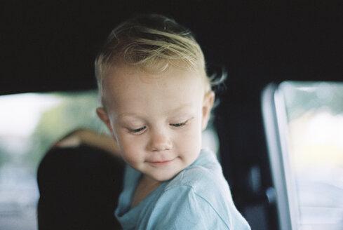 Smiling boy in car - CAVF21588