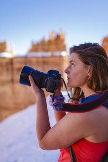 Hiker photographing while standing on mountain at Bryce Canyon National Park - CAVF22575