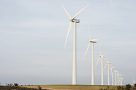 Wind turbines on field against clear sky - CAVF22635