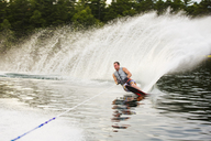 Man waterskiing in river at forest - CAVF23334