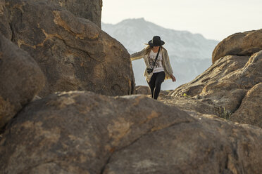 Young woman hiking on mountain against sky - CAVF23481